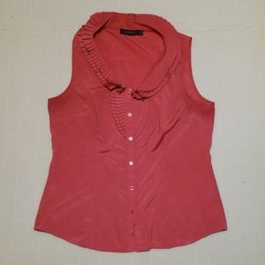 The limited womans ruffled neck blouse